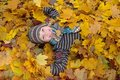 Boy In Autumn Leaves Royalty Free Stock Photos - 11821948