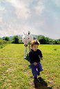 Boy Running From Horse. Stock Images - 11827084