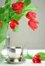 Cup Of Tea And Red Tulips Stock Photo - 11916070