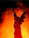Angel Silhouette On A Fire Texture Royalty Free Stock Photo - 12002545