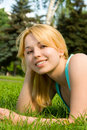 Woman Rest On The Grass Royalty Free Stock Images - 12022249