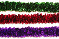 Green, Red And Purple Tinsel Isolated On White Stock Images - 12039094