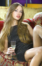 Rich Woman On Expensive Sofa Stock Photography - 12040632