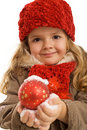 Little Girl Holding A Christmas Ball In Snow Stock Photography - 12065042