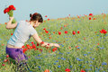 Girl Collecting Flowers Royalty Free Stock Photos - 12075288
