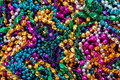 Background Of Mardi Gras Beads Stock Images - 12092774
