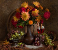 Still Life With Autumn Flowers And Wine Royalty Free Stock Images - 12135989