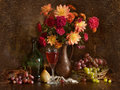Still Life With Autumn Flowers And Wine Royalty Free Stock Image - 12136026