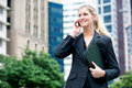 Businesswoman With Phone And File Royalty Free Stock Image - 12136726