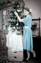 Retro Photo Of Teen Girl Decorating Christmas Tre Royalty Free Stock Images - 12160309