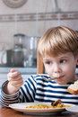 Little Boy Eating Stock Photography - 12181832