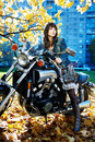 The Girl And Power Motorcycle Royalty Free Stock Photography - 12234597