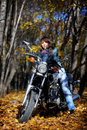 The Brunette Girl And Power Motorcycle Stock Images - 12234764