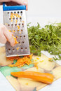 Grating Carrot Stock Photography - 12239122