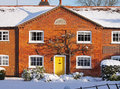 Red Brick English Rural Cottage In The Snow Royalty Free Stock Images - 12246099