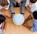 Close-up Of Business People Looking At A Globe Stock Image - 12254751