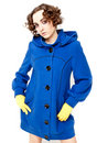 Woman In Blue Coat Posing Royalty Free Stock Photos - 12261108