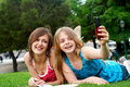 Two Girlfriends In Park Royalty Free Stock Images - 12336459