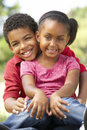 Portrait Of Brother And Sister In Park Stock Photos - 12404423