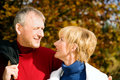 Mature Romantic Couple In A Park Royalty Free Stock Photography - 12408717