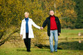 Mature Romantic Couple In A Park Stock Images - 12408824