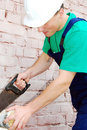 Muscular Young Builder. Royalty Free Stock Photography - 12415377