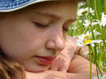 Girl With Daisies Royalty Free Stock Images - 12439379