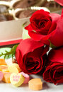 Roses And Candy Hearts Stock Image - 12467051
