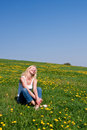 Young Woman Lying On A Meadow Royalty Free Stock Photo - 12470225