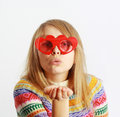 Cute Girl With Red Heart-shaped Glasses Blowing Ki Royalty Free Stock Photos - 12498998