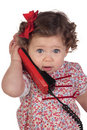 Funny Baby Girl With Red Telephone Stock Photography - 12509752