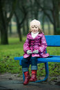 Girl Sits On Bench Royalty Free Stock Photos - 12569908