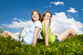 Young Girls Sitting In Meadow Stock Images - 12613074