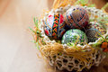 Easter Painted Eggs In Traditional Basket Royalty Free Stock Photos - 12663408