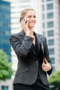 Businesswoman With Phone And File Royalty Free Stock Photos - 12694948