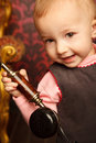 Portrait Of Little Girl Holds Up Retro Phone Royalty Free Stock Photography - 12729417