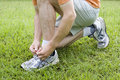 Jogger Tying His Shoes Royalty Free Stock Photography - 12800097