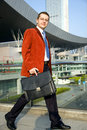 Walking Businessman With Suitcase Royalty Free Stock Photos - 12818918
