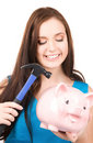 Teenage Girl With Piggy Bank And Hammer Stock Photos - 12826403