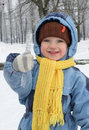 Cheerful Child Keeps Icicle Stock Image - 12873761