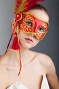 Beautiful Young Woman Wearing Red Carnival Mask Royalty Free Stock Photos - 12918708