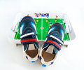 Sports Footwear Against A Toy Football Ground Royalty Free Stock Photos - 12943418
