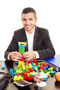 Businessman With Colorful Bricks Stock Photography - 12958082