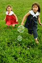 Ahhh To Be Young... Chasing Bubbles Royalty Free Stock Photos - 13034348
