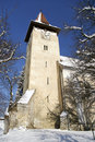 Church Tower In Winter Transylvanian Village Royalty Free Stock Images - 13056249