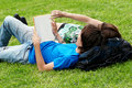 Couple Students Laying On The Grass Stock Photography - 13062532
