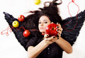Black Angel Girl Suggesting An Apple Stock Photography - 13062622