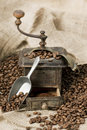 Old Coffee Grinder With Coffee Beans Royalty Free Stock Photos - 13107528