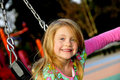 Young Girl Playing On Swing Stock Photo - 13149950