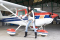 Pilot Woman Waiting To Fly Royalty Free Stock Images - 13180139